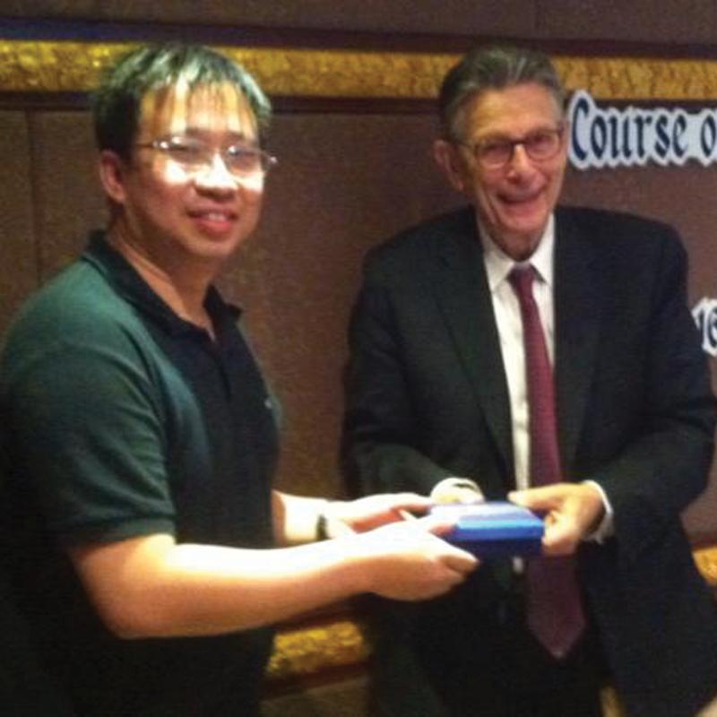 Receiving Award from Professor Norman Satorius