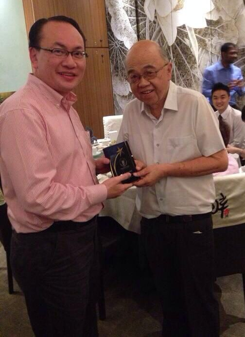 SPA AGM-Dr Chia receiving Distinguished Psychiatris Award from DR Lee Cheng
